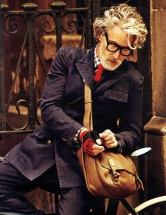 Gingham shirt, red tie, jacket, leather bag