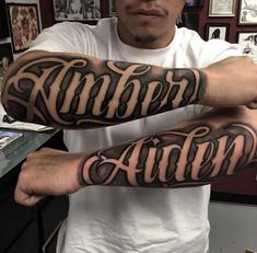 Choosing the right font style for your script tattoo as a man can be quite an uphill task. Whether you want a flashy design or a simple minimalistic look, you will be spoilt for choice with the thousands of options available. These twin tattoos say 'Amber' on one arm and 'Aiden' on another. They are represented in large cursive fonts to add formality. The twin tattoos obviously represent a couple and the typeface is common among tattoo fonts ideas.