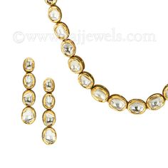 This piece of jewelry goes from Indian #Wedding Diva to Trendy Designer Dinner Party attire. Long necklace and earrings #set, exquisitely crafted in #22k yellow gold, studded with 9.35 carats of #polki stones in the the single strand design. The highlight of this necklace is the option of wearing it on both sides; the back side design features ravishing red colorful enamel work. - See more at: https://www.rajjewels.com/22-k-gold-long-polki-diamond-necklace-set.html#sthash.TWSnaosA.dpuf