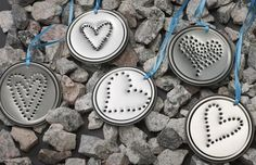 hearts punched into juice can lids. Cool except you have to have or buy juice cans.