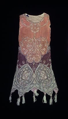 Evening dress  Callot Soeurs  (French, active 1895–1937)    Designer:      Madame Marie Gerber (French)  Date:      ca. 1923  Culture:      French  Medium:      silk, metal, pearl  Dimensions:      Length at CB: 47 in. (119.4 cm)