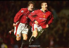 Eric Cantona celebrates scoring a goal with David Beckham