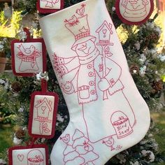 Woodland Snowman RedWork Stocking and Ornaments for Machine Embroidery. Mr. Snowman and his woodland feathered friends are fun to stitch in RedWork and will happily decorate any holiday home. The coordinating ornaments will feel at home snuggling on your tree or decorating a rustic twig wreath