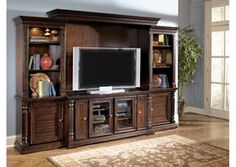 Our Key Town Entertainment Center adds traditional elements to your living space, with plenty of room for storage.