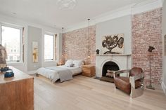 Exposed brick wall brings textural beauty to the posh bedroom -[Design Jensen C. Vasil Architect] via Exposed Brick Bedroom, Brick Wall Bedroom, Contemporary Bedroom, Modern Bedroom, Master Bedroom, Trendy Bedroom, Cozy Bedroom, Minimalist Bedroom, Classic Fireplace