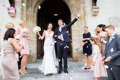 Flower shower at St. Andreas in Kitzbühel, Austria, wedding dress by Inbal Dror  bouquets: petra mueller blumen