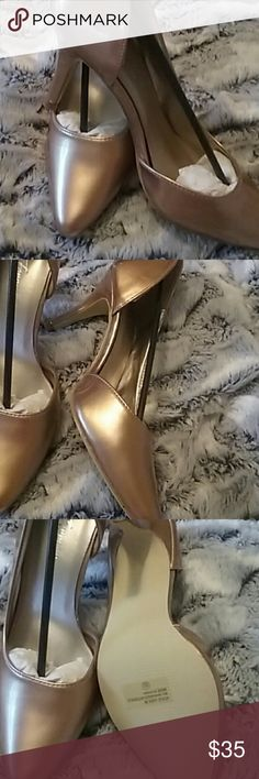NWT Rose Gold High Shine Open Side Pumps These pretty shoes feature a gleaming rose gold finish, and a cut out on the inside to help them really stand out. Feminine and professional. Shoes Heels