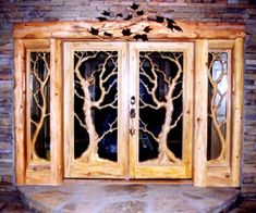 Carved Doors for Log Homes | Welcome to Doors And Mantles! Custom Hand Carved Doors and Mantles.