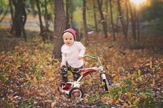 Fall child photo. Children's photography. Fall children's photo. Tricycle photo. Leaves falling photo. Outdoor photography. Natural light photography.   Http://www.facebook.com/BReinphotography