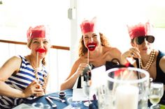 From a red, white, and blue-themed wedding at the Larchmont Yacht Club, as seen in our Wedding of the Month blog. Photography by Shannen Norman. Fun mustache, lip, and glasses masks for guests were at each table.
