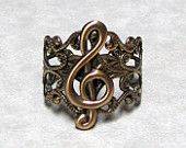 """""""Quarter Note Musical RIng.""""  Sweetheart... that's a treble cleff. Get your facts straight before selling your stuff."""