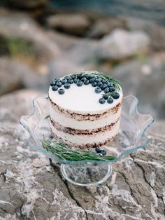 Simple, Naked Cake Topped with Blueberries & Rosemary | Photo: Alexander and Marina Santi.