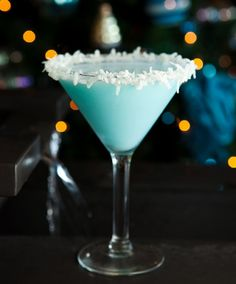 Coco Snowball.  Ingredients & Measurements:  2 oz. Vanilla Vodka  2 oz. Malibu Rum  2 oz. Coco Lopez  1/4 oz. Blue Curacao  Instructions:Pour all ingredients into shaker with ice. Shake and strain into glass. Rim glass with honey and shredded coconut.