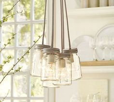 Pottery Barn: Exeter 5-Jar Pendant. Above the kitchen sink in front of the window?
