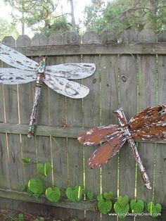 Take old wooden ceiling fan blades when the fan quits working and create yard art, like these butterflies.  Waterseal then polyurethane them well to prevent warping.