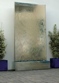 Water Wall in Stainless Steel: Self-contained Water Feature. David Harber, UK - I think this type of water feature is beginning to look a bit out of date. Wall Of Water, Water Walls, Water Wall Fountain, Indoor Water Features, Water Features In The Garden, Wall Water Features, Indoor Water Fountains, Indoor Fountain, Modern Fountain