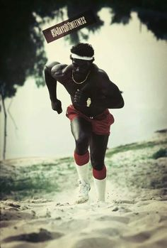 Walter Payton doing his training on a sandbank by the Pearl River near his hometown of Columbia, Miss.
