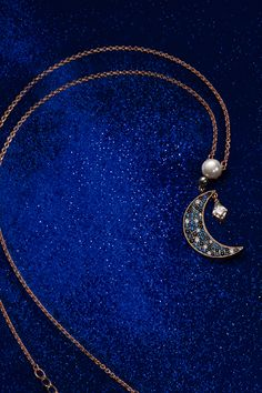 Beautiful Symbolic Pendant. Featuring moon and star motifs, which symbolize hopes and dreams, the rose-gold tone plated design of this cool-classic pendant boasts a delicate gradation of blue crystals set in pavé.