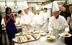 Michelle Obama in the White House kitchen - Courtesy of Business Insider