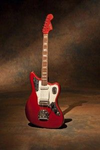 This is a 1971 Fender Jaguar in candy apple red finish with a matching headstock. A cool surf guitar. I recommend ample amounts of reverb from your twin with this guitar. Surfs up ladies and gents.