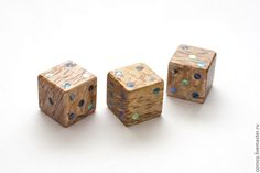 Wooden dice with pearl dots.
