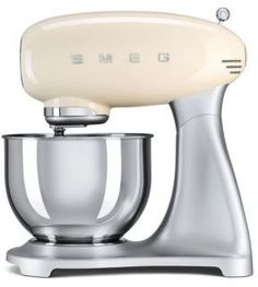 style meets modern convenience with this SMEG Retro Style tilt-head stand mixer. This stand mixer features a colored enamel powder-coated finish for a subtle accent to your kitchen decor, with a stainless steel bowl. 50 Style, Style Retro, Retro Styles, Smeg Stand Mixer, Stand Mixers, Small Appliances, Kitchen Appliances, Smeg Kitchen, Retro 50