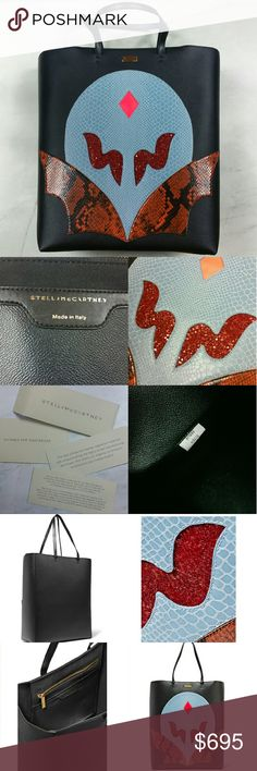"""STELLA MCCARTNEY Superstellaheroes tote bag Stella McCartney black Superstellaheroes tote. Black Faux leather with Multicolored (blue, burnt orange, red) glittered snake-effect appliqu?, designer plaque, gold hardware. Internal slit pocket. Open top. Fully lined in faux suede. Made in Italy. Measurements (approximately): 12.5""""W x 15""""H x 6""""D with 8"""" handle drop.   Brand new. Never worn. Comes with original dust bag. Can provide more pictures and info upon request. Make a reasonable offer…"""