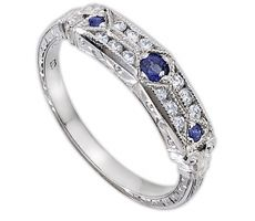 Vintage style Whitehouse Bros. ring. Love the sapphires!
