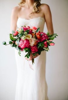 Colorful Bouquet of Garden Roses & Greens. Katie's Ojai, California wedding was bursting with citrus accents, and her bouquet, created by Brown Paper Design, was no exception. She toted this arrangement of garden roses, sweet peas, and ranunculus, all in shades of pink, white, and coral.