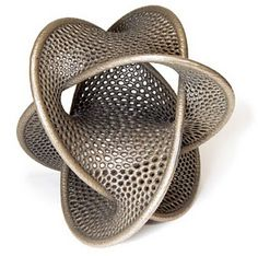 Wild Geometry Dropping Into The 3Rd Dimension    Bathsheba Grossman is a sculptor who uses cutting-edge technology to render math- and science-inspired shapes in three dimensions. You can buy 3D-printed laser-cut metal ones, or order them in plastic at lower costs from ShapeWays.