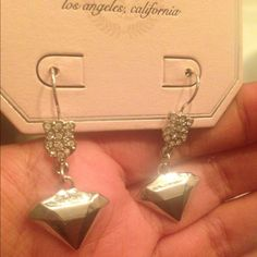 Juicy earrings Nwt, has big solid, silver diamond looking charm hanging, has a studded diamond looking figure on top of hanging charm, great for any occasion and season Juicy Couture Jewelry Earrings