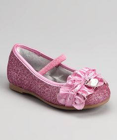 Put those pretty kitty paws in these glimmering ballet flats for a sweet look worthy of any model's catwalk. A stretchy strap and simple slip-on style are just a portion of the whole kitten caboodle.              Man-made Imported