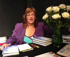"Me, enjoying my book launch and signing for my first book, a memoir ""A Butterfly's Journey"""