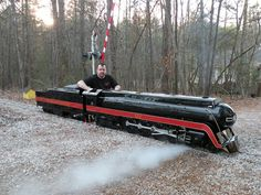 One of these for the backyard. (LOVE the idea of having a train and track for the yard)