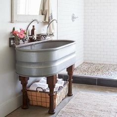 The workhorse of a sink in @myswallowsnest's Leiper's Fork cabin has repurposed wood legs from an old table. It's up for any chore! ( by Max Kim-Bee) #bathroom #sink