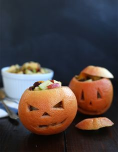 Grapefruit jack-o-lanterns filled with a fall harvest fruit salad. Yum!