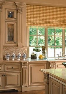 The pilasters with capitals & the bracket feet are the type of thing that makes cabinetry distinctive & truly custom looking.