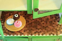 kitchen cabinet countertop tiled with pennies #kitchen #decor #diy