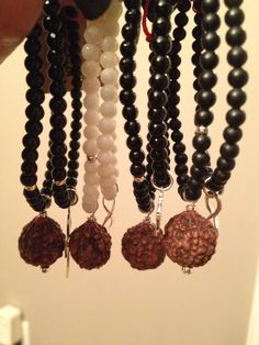 Tiny iSOLA.  Black Onyx, Sterling Silver, White Coral, Rudraksha Seeds blessed by Amma, the hugging saint