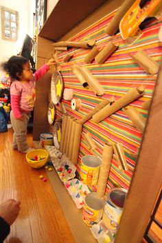 What a colorful and creative pom-pom run (cardboard tubes, egg cartons, pie tins, baby food snack containers, ribbon spools. Many hours of exploration and fun!