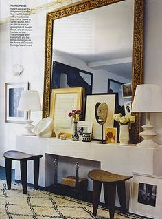 love the oversized mirror against the smaller frames and standing mask