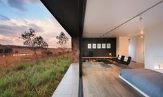 titled 'unfolding the land', the weekend house has been realized by w design architecture studio amid a majestic landscape of rolling hills. Lean To Roof, House Plans South Africa, Mountain Cottage, Rural Retreats, Weekend House, Outdoor Seating Areas, Terra, The Great Outdoors, Habitats