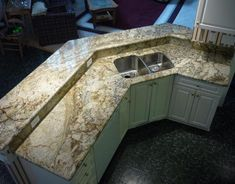 Sienna Bordeaux granite with white cabinets.  Gorgeous!