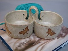 Double yarn bowl with dragonflies by wildduckpottery1 on Etsy, $46.00