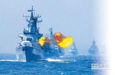 5月24日,中俄「海上聯合—2014」軍事演習,中國海軍哈爾濱艦主炮對海上目標進行射擊。 (新華社)