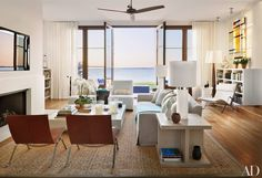 For his new home in Sag Harbor, New York, architect Frank Greenwald hired decorators Foley & Cox to create relaxed, comfortable interiors. In the living room, the duo placed a linen-clad Christian Liaigre sofa and a pair of Poul Kjærholm leather-and-steel lounge chairs around a cocktail table by FTF Design Studio.