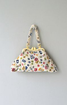 Vintage 1940s celluloid frame handbag entirely beaded with game motif (cards, dominos, mahjong, etc.), celluloid chain handle and cream silk lining.