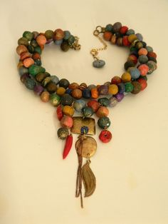 Tri strand Multi colour Mushana paper bead statement  necklace with  hand made ethnic inspired focal point