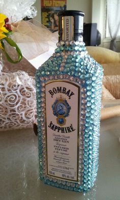 Great gift to bring to a party; bedazzle a liquor bottle for your host/friend. Fantastic!