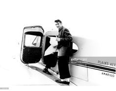 April 14, 1956 Rock and roll singer Elvis Presley boards a plane headed to Memphis, Tennessee in Nashville, Tennessee.